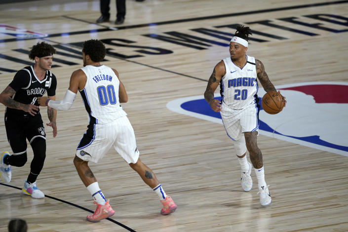 Orlando Magic's Markelle Fultz (20) brings the ball down the court during the first half of an NBA basketball game against the Brooklyn Nets Friday, July 31, 2020, in Lake Buena Vista, Fla. (AP Photo/Ashley Landis, Pool)