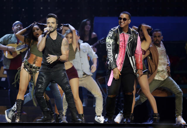 "FILE – In this April 27, 2017 file photo, singers Luis Fonsi, left and Daddy Yankee perform during the Latin Billboard Awards in Coral Gables, Fla. The ubiquitous hit song ""Despacito"" has tied Mariah Carey's 16-week record at No. 1 on the Billboard Hot 100 chart. Billboard announced Monday, Aug. 28, that Luis Fonsi's song and Carey's duet with Boyz II Men, ""One Sweet Day,"" are the longest-running No. 1 songs in the 59-year history of the charts. (AP Photo/Lynne Sladky, File)"