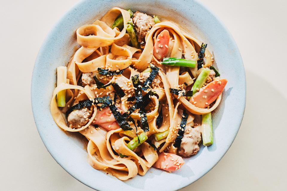 """You can swap in any kind of ground meat and any kind of vegetable for this saucy, clean-out-your-pantry rice noodle dish. But we really like it with ground pork. <a href=""""https://www.epicurious.com/recipes/food/views/hot-sesame-noodles-with-scallions-and-pork?mbid=synd_yahoo_rss"""" rel=""""nofollow noopener"""" target=""""_blank"""" data-ylk=""""slk:See recipe."""" class=""""link rapid-noclick-resp"""">See recipe.</a>"""