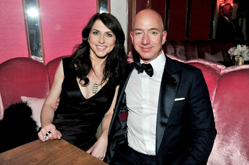 CEO of Amazon Jeff Bezos (R) and writer MacKenzie Bezos attend the Amazon Studios Oscar Celebration at Delilah on February 26, 2017 in West Hollywood, California (AFP Photo/Jerod Harris)
