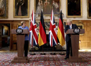 Britain's Prime Minister Boris Johnson, right and German Chancellor Angela Merkel, take part in a press conference after their meeting at Chequers, the country house of the Prime Minister, in Buckinghamshire, England, Friday July 2, 2021. Johnson is likely to push Angela Merkel to drop her efforts to impose COVID-19 restrictions on British travelers as the German chancellor makes her final visit to Britain before stepping down in the coming months. Johnson will hold talks with Merkel at his country residence on Friday. (Jonathan Buckmaster//Pool Photo via AP)