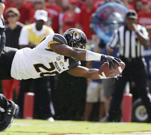 Missouri running back Henry Josey dives in for a touchdown during the second half of an NCAA college football game against Georgia Saturday, Oct. 12, 2013 in Athens, Ga. Missouri won 41-26. (AP Photo/John Bazemore