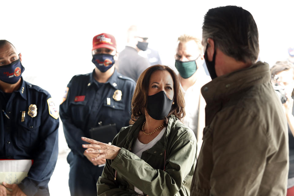 Democratic vice presidential candidate Sen. Kamala Harris, D-Calif., and California Gov. Gavin Newsom discuss the damage during the Creek Fire at Pine Ridge Elementary, Tuesday, Sept. 15, 2020 in Auberry, Calif. (AP Photo/Gary Kazanjian)