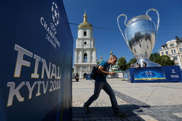 A giant replica of the UEFA Champions League trophy is on display in front of the Saint Sophia's Cathedral in central Kiev, Ukraine May 23, 2018. REUTERS/Valentyn Ogirenko