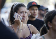 <p>People speak on their phones as they stand on a street in Barcelona, Spain, Aug. 17, 2017. Police in the northern Spanish city of Barcelona say a white van has jumped the sidewalk in the city's historic Las Ramblas district, injuring several people. (Manu Fernandez/AP) </p>