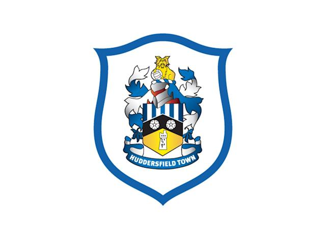"<p>Coached by former USA international David Wagner and now Yorkshire's only Premier League club, Huddersfield adopted the ""Terriers"" nickname in the late 1960s. It's not the fiercest mascot, but it's appropriate for a smaller club hoping to do big things. Much of the famous Yorkshire Terrier breed can trace its lineage back to Huddersfield Ben, an accomplished show dog from the city. The shield underneath the terrier includes a black chevron symbolizing the River Colne, nearby Castle Hill and two Yorkshire roses. </p>"