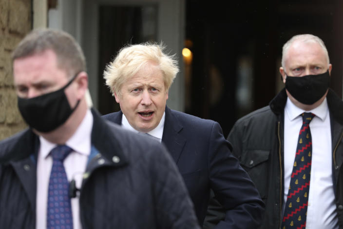 British Prime Minister Boris Johnson leaves after speaking to the media with Conservative Party candidate Jill Mortimer, who won the Hartlepool by-election, at Hartlepool Marina, in Hartlepool, north east England, Friday, May 7, 2021. Britain's governing Conservative Party made further inroads in the north of England on Friday, winning a by-election in the post-industrial town of Hartlepool for a parliamentary seat that the main opposition Labour Party had held since its creation in 1974. (AP Photo/Scott Heppell)