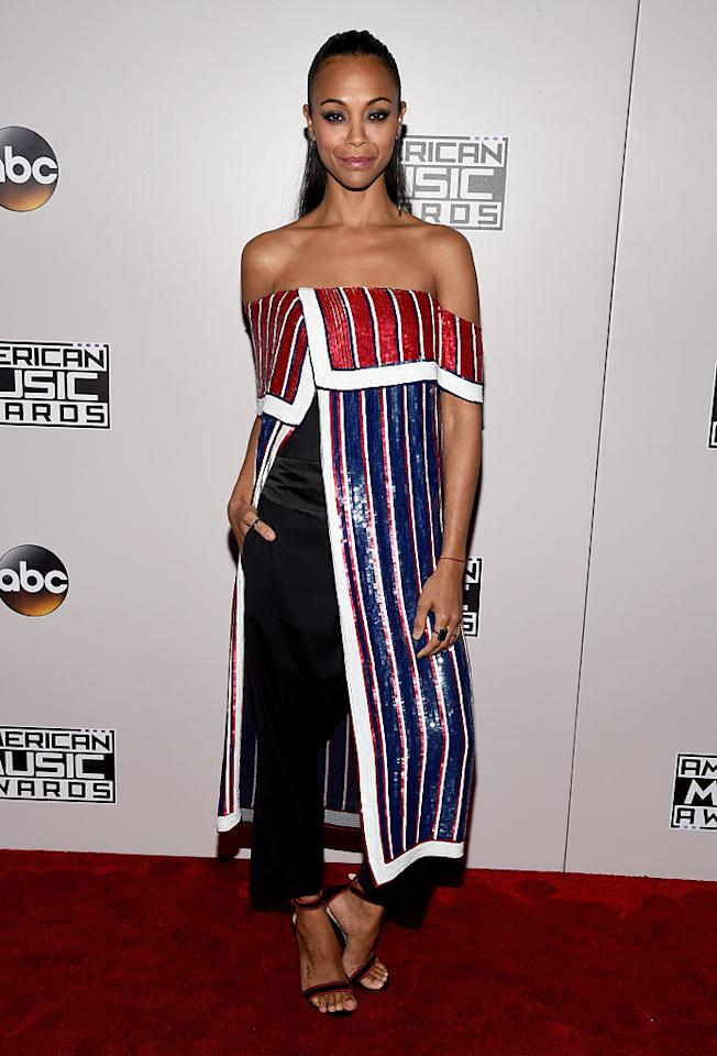 <p>Salanda wore a red, white, and blue striped sequin dress and black trousers to the 2016 American Music Awards on Nov. 20, 2016, in Los Angeles. Her patriotic, off-the-shoulder ensemble stood out and worked well with her slicked-back hairstyle. <em>(Photo: Getty Images)</em> </p>