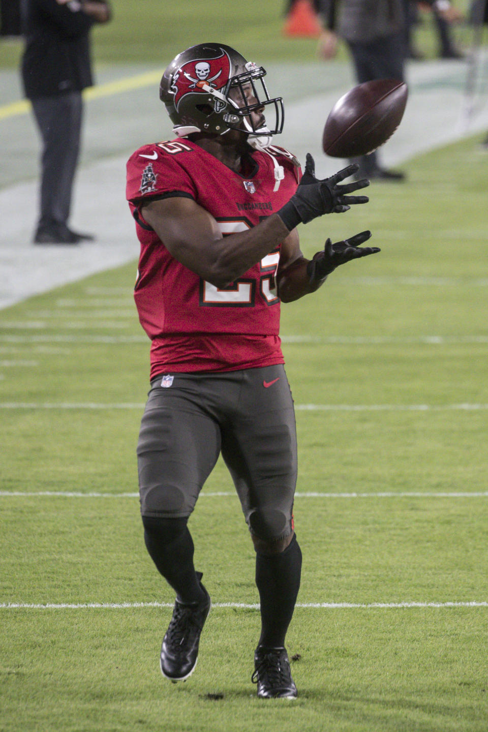 Tampa Bay Buccaneers running back LeSean McCoy (25) catches a pass during warm-ups prior to an NFL game against the New Orleans Saints, Sunday, Nov. 8, 2020 in Tampa, Fla. The Saints defeated the Buccaneers 38-3. (Margaret Bowles via AP)