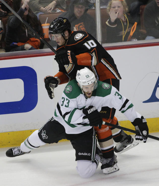 Dallas Stars' Alex Goligoski (33) collides with Anaheim Ducks' Corey Perry (10) during the second period of Game 5 of the first-round NHL hockey Stanley Cup playoff series on Friday, April 25, 2014, in Anaheim, Calif. (AP Photo/Jae C. Hong)