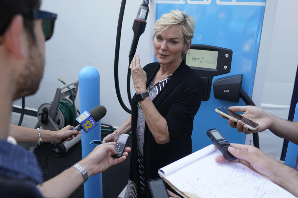 Secretary of Energy Jennifer Granholm talks to reporters after a ribbon cutting for an electric vehicle charging hub in the Brooklyn borough of New York, Tuesday, June 29, 2021. Granholm is visiting the state to promote President Joe Biden's sweeping infrastructure plan. (AP Photo/Seth Wenig)