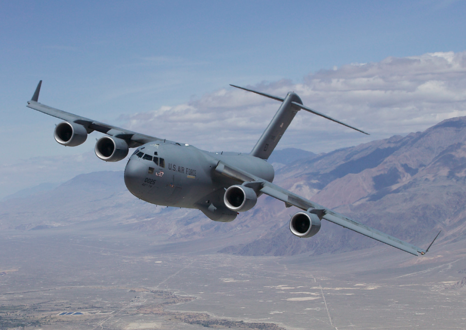 """<p>The hefty Globemaster III cargo aircraft can carry a 69-ton M1 Abrams main battle tank, 170,900 pounds of gear, or up to <a href=""""https://www.af.mil/About-Us/Fact-Sheets/Display/Article/1529726/c-17-globemaster-iii/"""" rel=""""nofollow noopener"""" target=""""_blank"""" data-ylk=""""slk:102 fully-equipped paratroopers"""" class=""""link rapid-noclick-resp"""">102 fully-equipped paratroopers</a>. Despite its huge cargo capacity, the C-17 is built to operate from small and primitive airfields and can travel 2,400 nautical miles without refueling.</p>"""