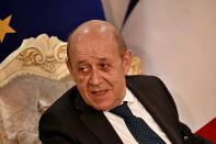 French Foreign Minister Jean-Yves Le Drian, meets with his meet his Iraqi counterpart Fouad Hussein in Baghdad, Iraq, Thursday, July 16, 2020. (AP Photo/Hadi Mizban)