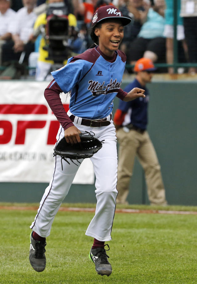 FILE - In this Aug. 15, 2014, file photo, Pennsylvania pitcher Mo'ne Davis celebrates after getting the final out of a 4-0 shutout against Tennessee during a baseball game in United States pool play at the Little League World Series tournament in South Williamsport, Pa. Davis has been named The Associated Press 2014 Female Athlete of the Year. At just 13, she is the youngest winner ever. (AP Photo/Gene J. Puskar, File)