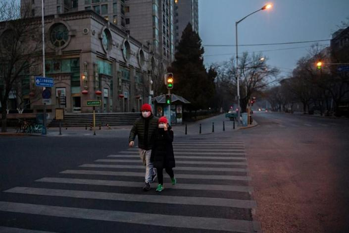 Many streets in Beijing are nearly empty amid fears over the coronavirus epidemic -- with the death toll soaring above 100, China and foreign governments are stepping up measures to try to contain it (AFP Photo/NICOLAS ASFOURI)