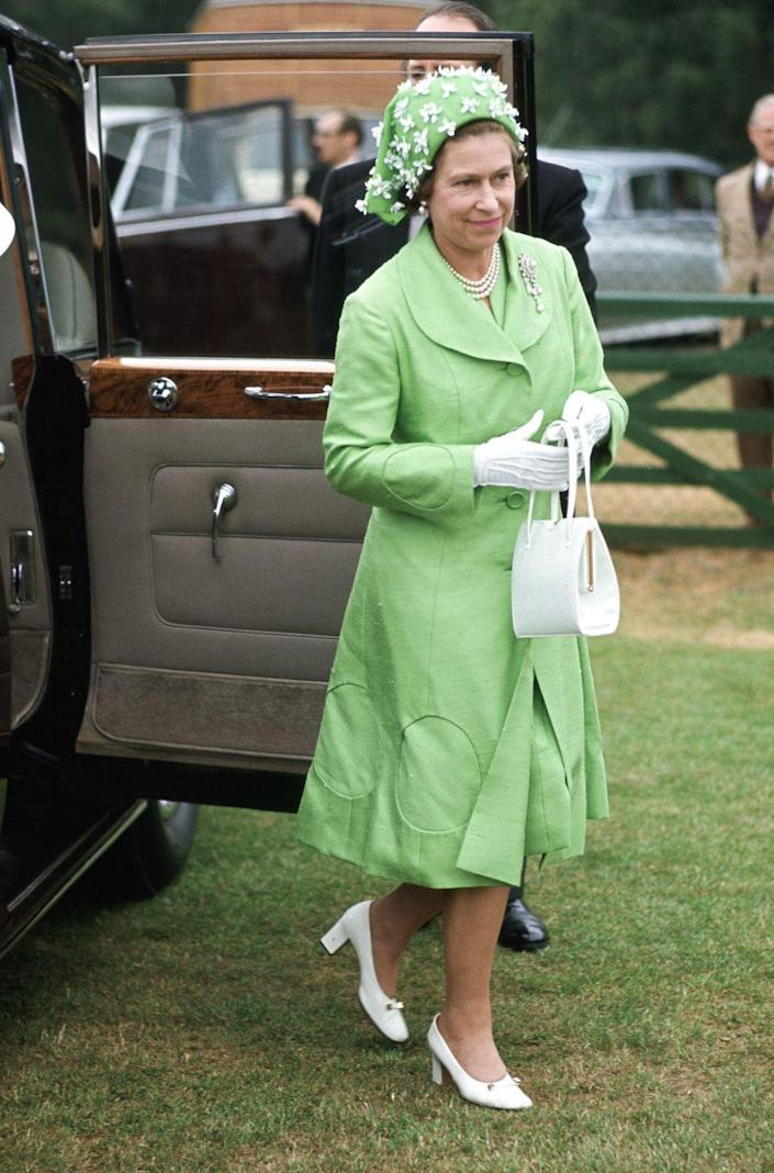 <p>The Queen is a monochrome maven from way back, as seen in this mint green look she put together in 1973.</p>