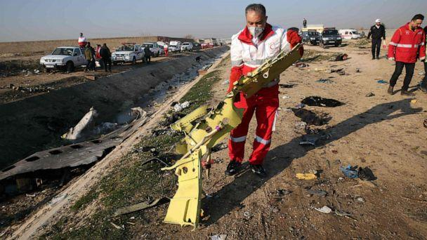 PHOTO: Rescue teams recover debris from a field after a Ukrainian plane carrying 176 passengers crashed near Imam Khomeini airport in the Iranian capital Tehran early in the morning on Jan. 8, 2020, killing everyone on board. (AFP via Getty Images)