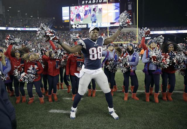 More reason to dance: Martellus Bennett has offered to help a Chicago high school championship team get rings. (AP)