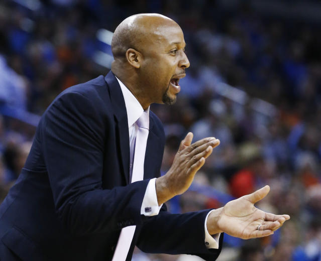 Denver Nuggets head coach Brian Shaw shouts to his team in the second quarter of an NBA basketball game against the Oklahoma City Thunder in Oklahoma City, Monday, Nov. 18, 2013. (AP Photo/Sue Ogrocki)