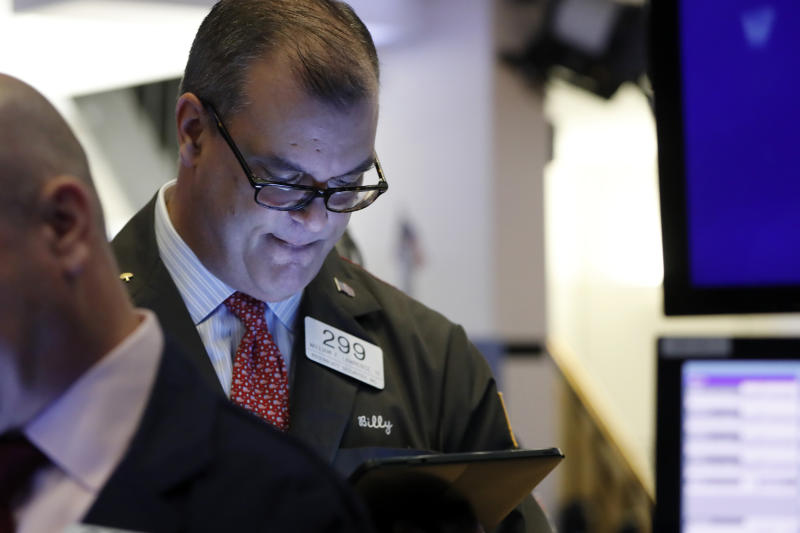 Trader William Lawrence works on the floor of the New York Stock Exchange, Friday, Feb. 14, 2020. U.S. stocks wobbled between small gains and losses in early trading Friday as investors focused on another round of mostly solid corporate earnings. (AP Photo/Richard Drew)