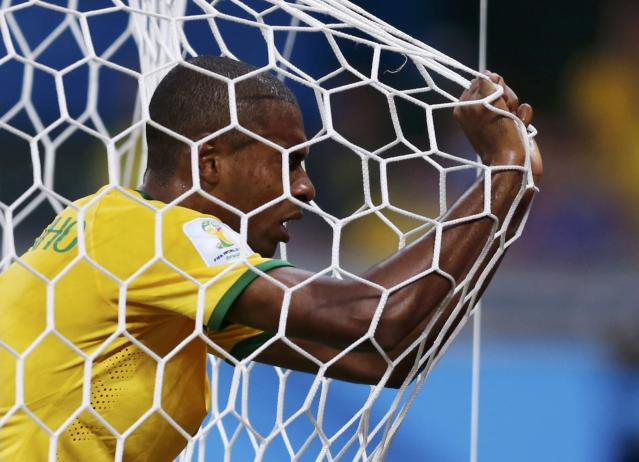 Brazil's Fernandinho reacts in his goal's net after they conceded a goal to Germany during their 2014 World Cup semi-finals at the Mineirao stadium in Belo Horizonte July 8, 2014. REUTERS/Marcos Brindicci (BRAZIL - Tags: SOCCER SPORT WORLD CUP TPX IMAGES OF THE DAY)
