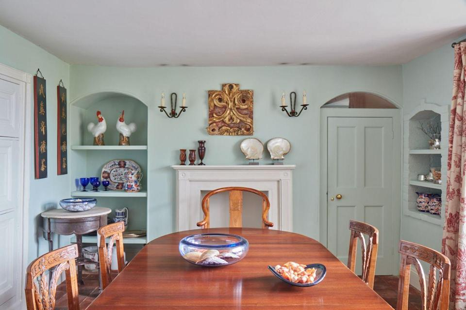 """<p>""""It is painted in Donato's Eau de Nil, again by Francesca's paints, and it contrasts so well with the mahogany furniture and the antique Chinese horseshoe chair at the head of the table. The Chinese signs on the wall are lacquered, and I thought they were from a temple, but in fact they are signs for a tea house.""""</p>"""