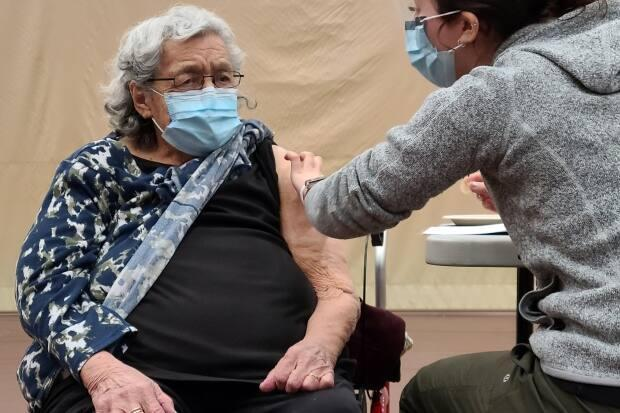 Elder Joan Peters, who got her first dose of the Pfizer-BioNTech vaccine in Musqueam on Tuesday says, 'Everyone should get it done, I'd say.'