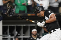 Chicago White Sox's Jose Abreu is hit by a pitch during the eighth inning of the team's baseball game against the Cleveland Indians in Chicago, Friday, July 30, 2021. (AP Photo/Nam Y. Huh)