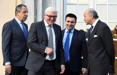 REFILE - Foreign ministers (L-R) Sergei Lavrov of Russia, Frank-Walter Steinmeier of Germany, Pavlo Klimkin of Ukraine and Laurent Fabius of France arrive for a picture opportunity ahead of their meeting at the German foreign ministry's Villa Borsig at lake Tegel in Berlin, Germany September 12, 2015. REUTERS/Tobias Schwarz/Pool