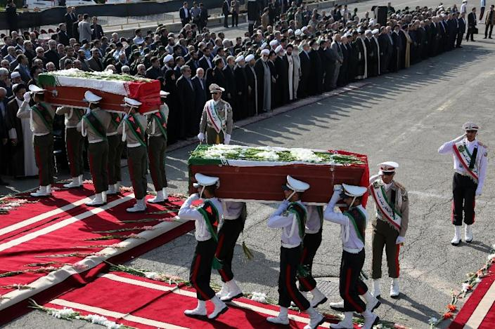 The Iranian honour guard carries the coffins of Iranian pilgrims killed in a stampede at the annual hajj, during a repatriation ceremony on October 3, 2015 at Tehran's Mehrabad Airport (AFP Photo/Atta Kenare)