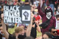 People participate in a Black Lives Matter protest rally in Hyde Park, London, in memory of George Floyd who was killed on May 25 while in police custody in the US city of Minneapolis. (Photo by Victoria Jones/PA Images via Getty Images)