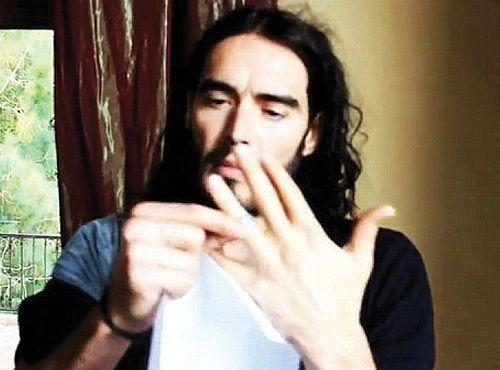 Russell Brand takes off his wedding ring in a video promoting a college tour. Credit: You Tube.