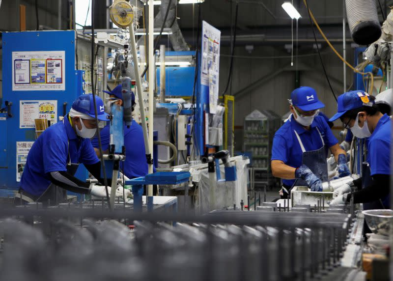 FILE PHOTO: Workers wearing protective face masks are seen along the assembly line, amid the coronavirus disease (COVID-19) outbreak, at Marelli's factory in Ora Town