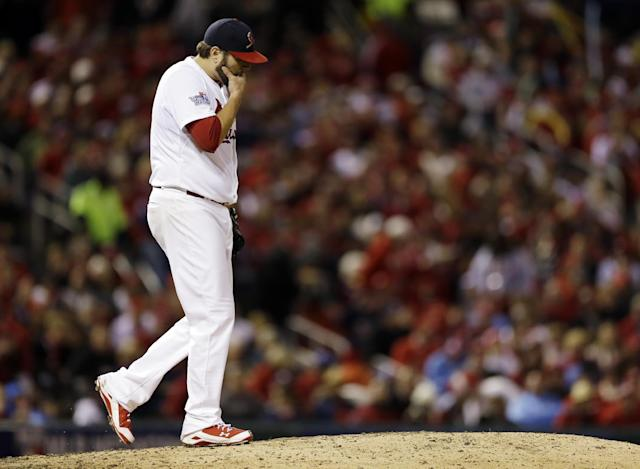 St. Louis Cardinals starting pitcher Lance Lynn walks back to the mound after giving up a run during the fifth inning of Game 4 of baseball's World Series against the Boston Red Sox Sunday, Oct. 27, 2013, in St. Louis. (AP Photo/Jeff Roberson)