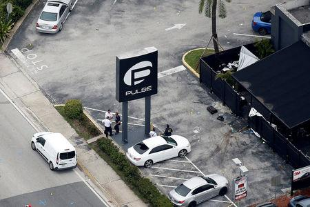 File Photo: Investigators work the scene following a mass shooting at the Pulse gay nightclub in Orlando Florida, U.S. June 12, 2016. REUTERS/Carlo Allegri/File Photo