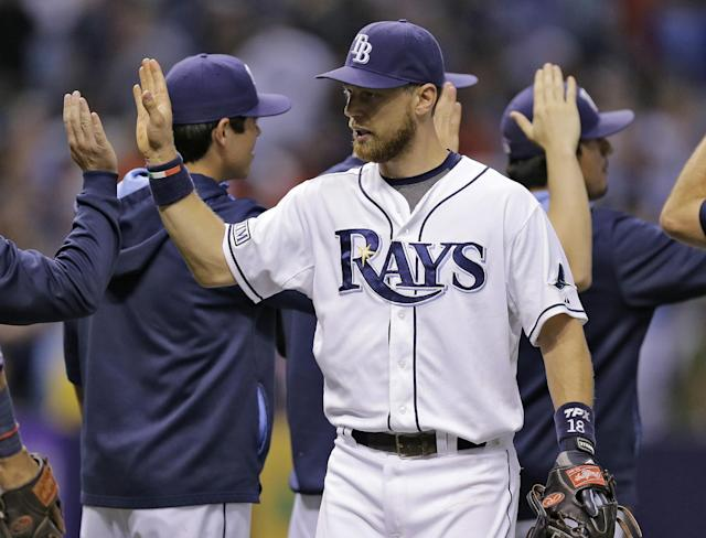 Tampa Bay Rays' Ben Zobrist high-fives teammates after the Rays defeated the Boston Red Sox 3-0 in a baseball game Saturday, July 26, 2014, in St. Petersburg, Fla. (AP Photo/Chris O'Meara)