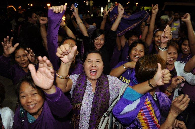 Supporters of the Reproductive Health Bill celebrate as legislators pass a landmark birth control bill at the House of Representatives, in Quezon City, suburban Manila, on December 17, 2012. The controversial birth control law came into effect on Thursday after more than a decade of bitter opposition from the influential Catholic church, with women saying the change comes as a relief