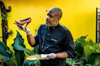 Master chocolatier Ralph Leroy, who owns the chocolate company Makaya in Petionville, Haiti, holds one of his creations: a high-heeled shoe made of chocolate