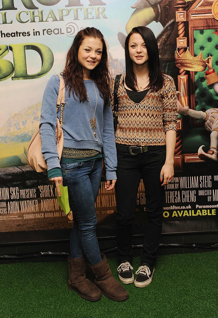 Megan and Kathryn Prescott attend the premiere of