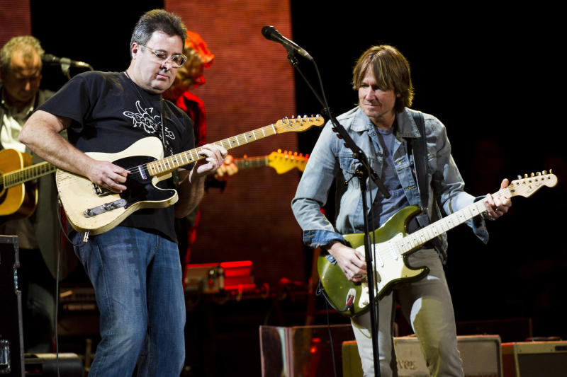 Vince Gill, left, and Keith Urban perform at Eric Clapton's Crossroads Guitar Festival 2013 at Madison Square Garden on Saturday, April 13, 2013, in New York. (Photo by Charles Sykes/Invision/AP)