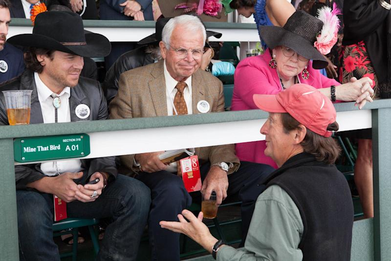 "In this Oct. 18, 2012 image provided by Allied-THA, from left to right, Mark Allen, played by actor Christian Kane, Leonard 'Doc' Blach played by William Devane, producer and director Jim Wilson and Joanne Blach, played by Tish Rayburn-Miller, talk about a scene during filming at Churchill Downs for the movie ""50-1."" (AP Photo/Ben Glass, Courtesy of Allied-THA)"