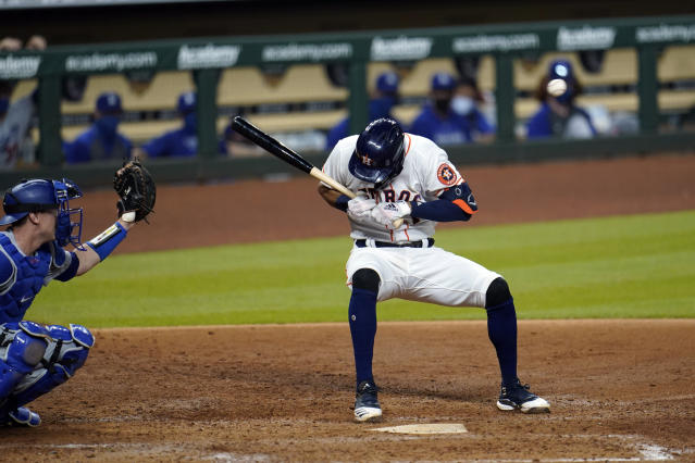 Houston Astros' Carlos Correa, right, ducks from a pitch thrown by Los Angeles Dodgers relief pitcher Joe Kelly as catcher Will Smith reaches for the ball during the sixth inning of a baseball game Tuesday, July 28, 2020, in Houston. Both benches emptied after the inning. (AP Photo/David J. Phillip)