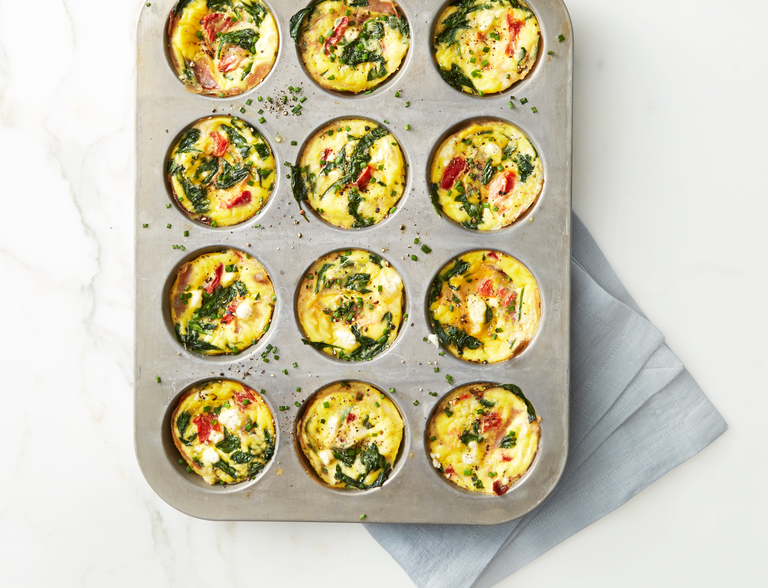 """<p>These <a href=""""https://www.prevention.com/food-nutrition/recipes/g25400067/breakfast-egg-muffins/"""" rel=""""nofollow noopener"""" target=""""_blank"""" data-ylk=""""slk:egg muffins"""" class=""""link rapid-noclick-resp"""">egg muffins</a> belong in your breakfast rotation. They're essentially a remix of a Greek omelette, but with more veggies at only 65 calories a pop. One batch can last a whole week, too!<br></p><p><a href=""""https://www.prevention.com/food-nutrition/recipes/a26991201/spinach-goat-cheese-egg-muffins-recipe/"""" rel=""""nofollow noopener"""" target=""""_blank"""" data-ylk=""""slk:Get the recipe from Prevention »"""" class=""""link rapid-noclick-resp""""><strong><em>Get the recipe from Prevention »</em></strong></a></p>"""