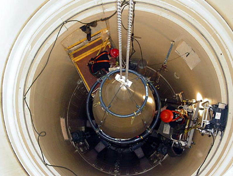 """In this image released by the U.S. Air Force, a Malmstrom Air Force Base missile maintenance team removes the upper section of an ICBM at a Montana missile site. An Air Force unit that operates one-third of the nation's land-based nuclear missiles at Malmstrom Air Force Base, Mont., has failed a safety and security inspection, marking the second major setback this year for a force charged with the military's most sensitive mission, Lt. Gen. James M. Kowalski, who is in charge of the nuclear air force told The Associated Press on Tuesday, Aug. 13, 2013. He said a team of """"relatively low ranking"""" airmen failed one exercise as part of a broader inspection, which began last week and ended Tuesday. He said that for security reasons he could not be specific about the team or the exercise. (AP Photo/U.S. Air Force, John Parie)"""