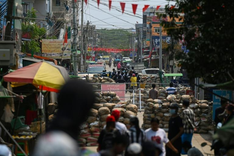 Makeshift barricades erected by protesters are seen along a road in Yangon on March 13, 2021, as security forces continue to crackdown on demonstrations against the military coup.