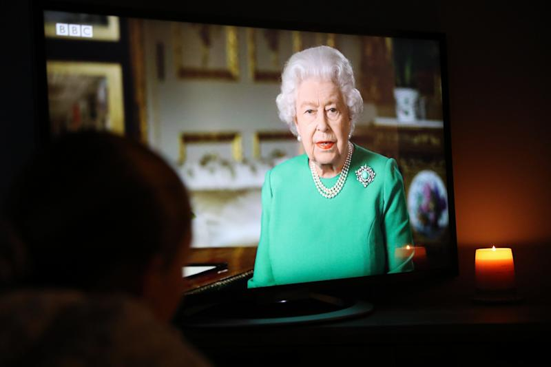 Mia Wilson, aged 12 from Derbyshire watches Queen Elizabeth II deliver her address to the nation and the Commonwealth in relation to the coronavirus epidemic. (Photo by Scott Wilson/PA Images via Getty Images)