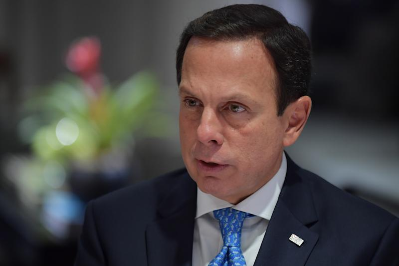 Sao Paulo's Governor Joao Doria speaks during an interview with AFP in Sao Paulo, Brazil, on March 26, 2020. - Doria, the leader of the front of governors who challenge Bolsonaro, affirms he is determined along with his 26 Brazilian peers to supply the absences of President Jair Bolsonaro in the fight against the coronavirus, as well as in the socio-economic challenges of the quarantine measures. (Photo by NELSON ALMEIDA / AFP) (Photo by NELSON ALMEIDA/AFP via Getty Images)