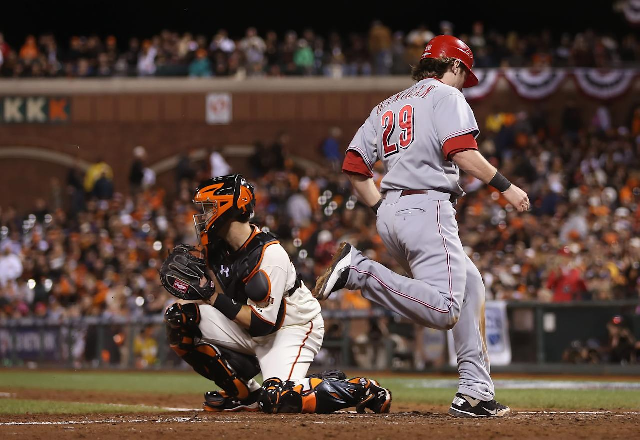SAN FRANCISCO, CA - OCTOBER 07:  Ryan Hanigan #29 of the Cincinnati Reds scores a run past catcher Buster Posey #28 of the San Francisco Giants in the eighth inning during Game Two of the National League Division Series at AT&T Park on October 7, 2012 in San Francisco, California.  (Photo by Jeff Gross/Getty Images)
