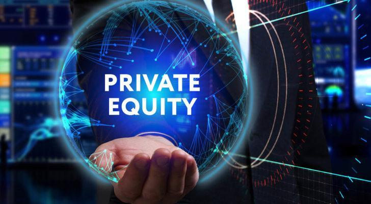 """A businessman holds a holographic logo that says """"private equity."""""""