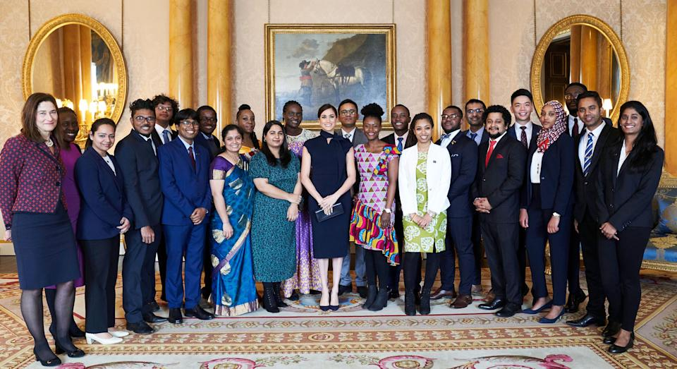 EMBARGOED TO 2130 WEDNESDAY MARCH 11 Handout picture released by the Duke and Duchess of Sussex showing the Duchess of Sussex, Patron of the Association of Commonwealth Universities (ACU), meeting Commonwealth Scholars, Chevening Scholars and an ACU Blue Charter Fellow from 11 Commonwealth countries - Malawi, India, Cameroon, Bangladesh, Nigeria, Pakistan, Ghana, Rwanda, Kenya, Malaysia and Sri Lanka - at Buckingham Palace in London before they all attended the Commonwealth Service.